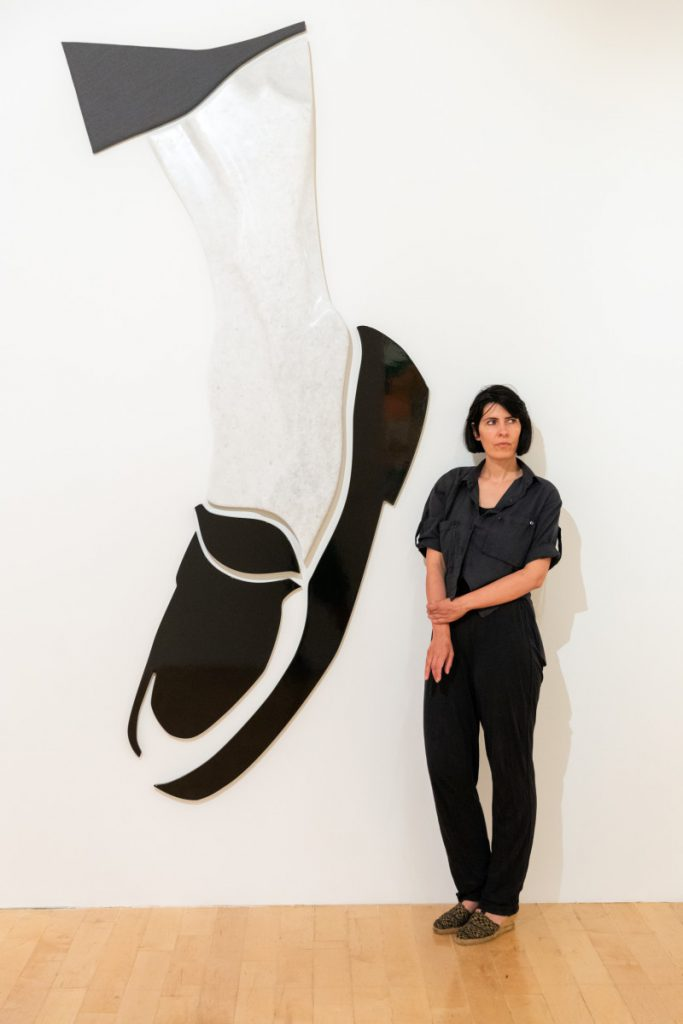 Image: portrait of Rallou Panagiotou (with the work No More Black Shoe, 2019) photo by Paris Tavinian
