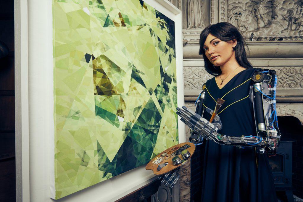 Ai-Da Robot with Painting_(Photographer Nicky Johnston)